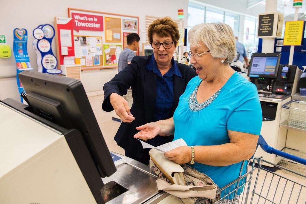 Tesco customer at self checkout
