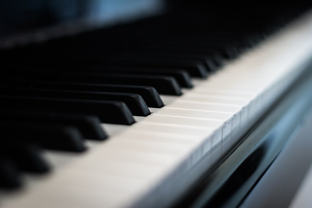 dramatic closeup of piano keyboard