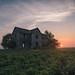 Abandoned farmhouse at sunrise, rural Iowa by buckchristensen