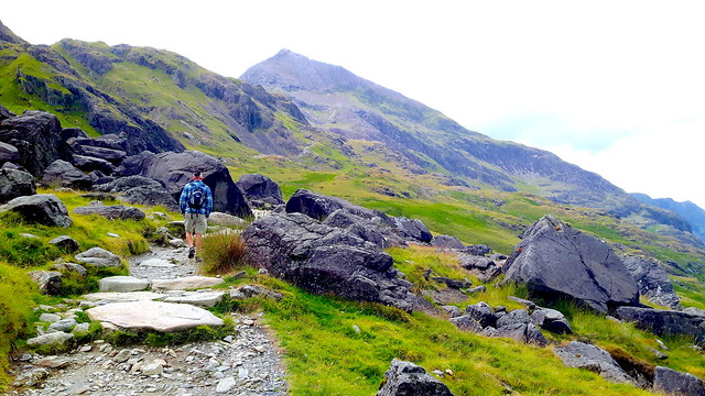 A man on a hiking trail in the mountains - Snowdon, Wales