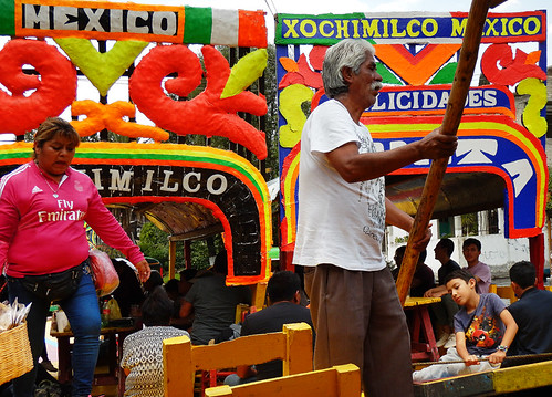 UNESCO Heritage Site Xochimilco with its bright boat piloted by Rafeal