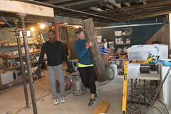 Rep. Cummings removes part of a beam being replaced in the basement of a Habitat for Humanity build in Waterbury.