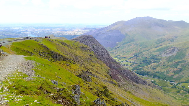 Mountainous hills with a small train in the background on Mount Snowdon.