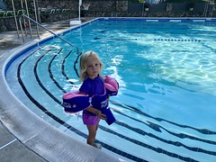 Madeleine gets ready to swim with floaties on for the first time