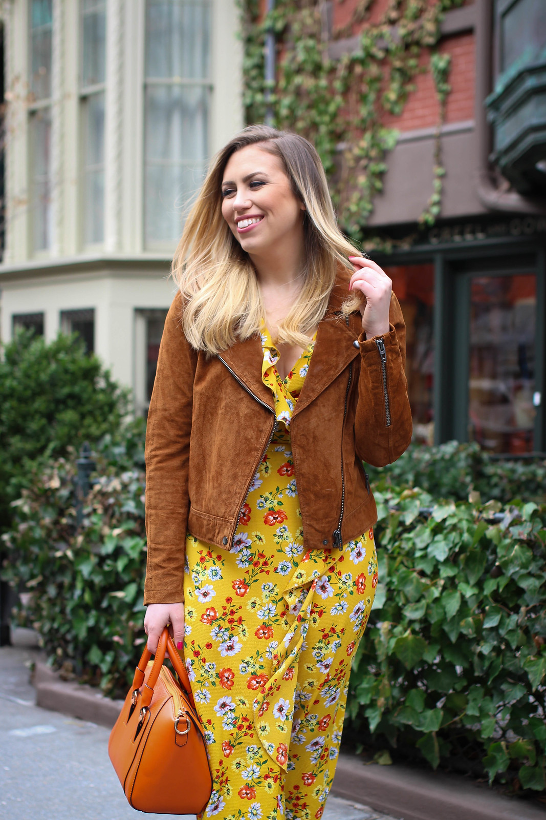 Spring Outfit BLANK NYC Cinnamon Suede Moto Jacket Yellow Floral Wrap Dress Outfit