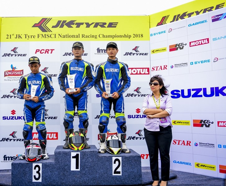 Suzuki Gixxer Redbull Road to Rookies_Race 1 - (L to R) Jerome Vanlalrengpuia, Zothanmawia and PC Andy Lalhmangaihsang with Deepali Mishra, Head of Marketing, SMIPL  (Copy)