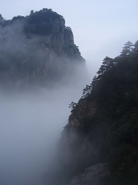 Fog curls around the peaks of Mt Lu (Lushan) in Jiangxi province, China Mount Lu, where the Chinese Pure Land tradition was founded