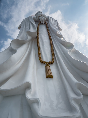 budha china clouds hainan nanshan prayerbeads statue sculpture outdoor monument white religion religiousbelief outerwear person prayer beads up buddhism guanyin temple guilin sanya