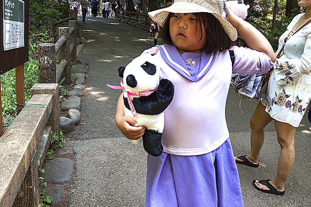 Girl with panda bear--Tokyo