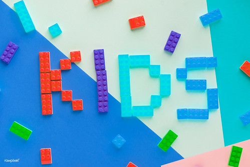 Kids spelled word with plastic blocks background | by Rawpixel Ltd