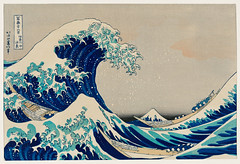 Kanazawa Oki Nami Ura by Katsushika Hokusai (1760-1849) a traditional Japanese Ukyio-e style illustration of extreme waves bearing down on the boats with a view of Mount Fuji. Digitally enhanced from our own original edition.