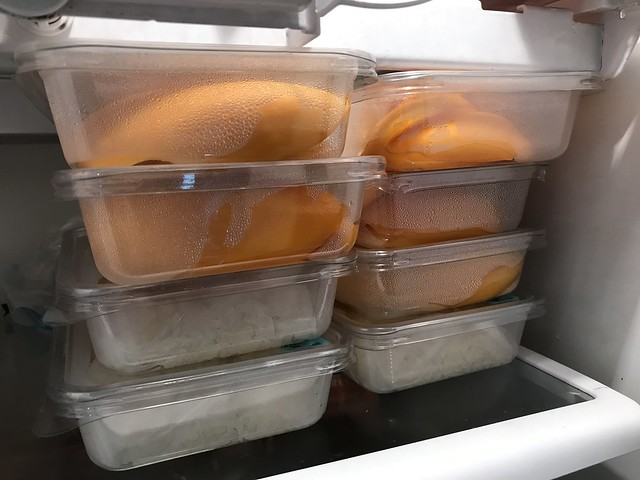 trays of sticky rice with mangoes