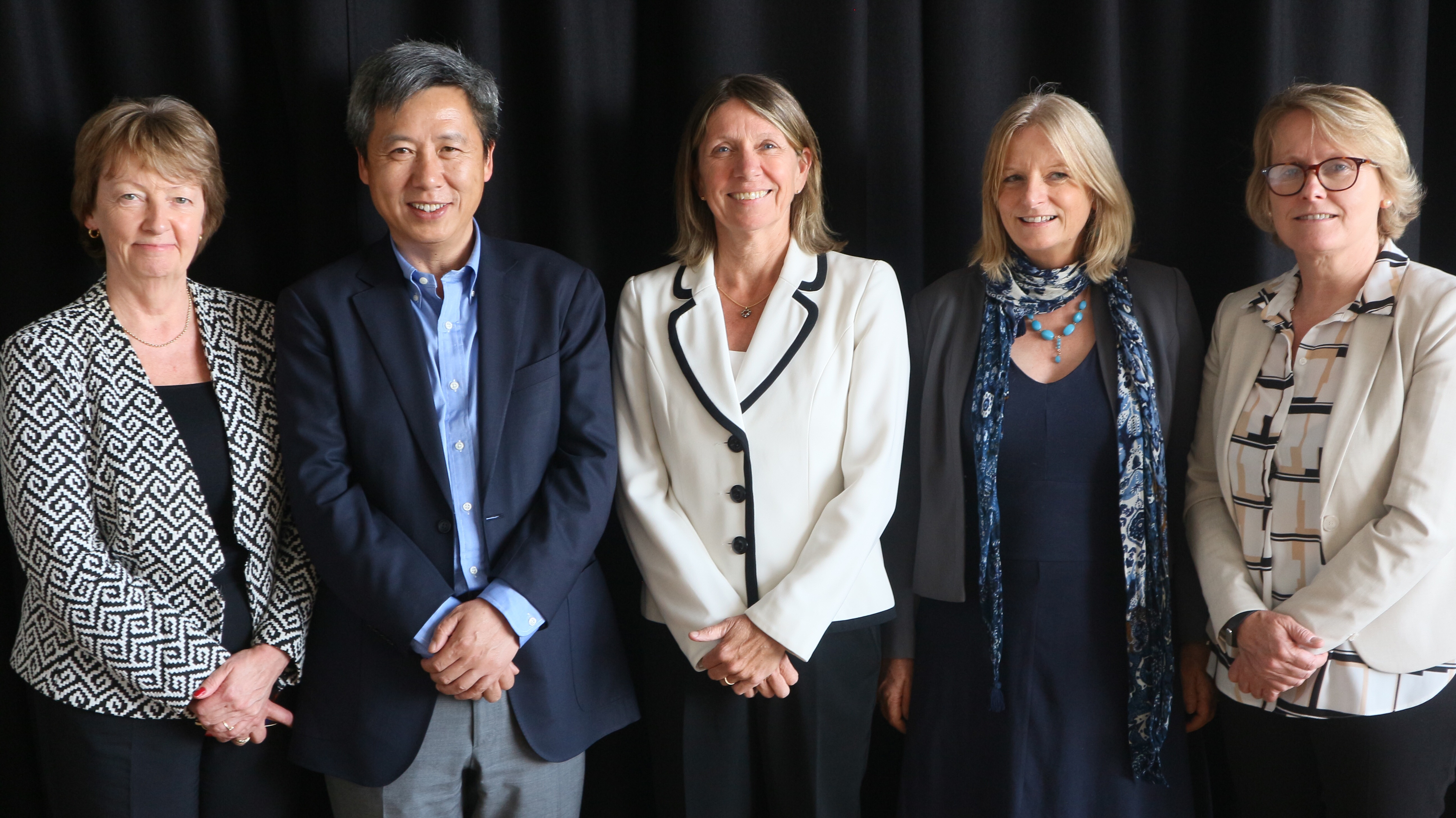 Photo of Professor Yong Zhao being welcomed by staff from the International Relations Office