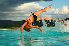 swimming(0.0), sports(0.0), water sport(0.0), freestyle swimming(0.0), jumping(1.0), individual sports(1.0), sea(1.0), recreation(1.0), outdoor recreation(1.0), swimmer(1.0), physical fitness(1.0),
