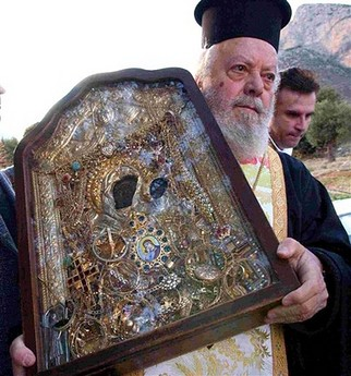 Greek orthodox monk carries the icon of The Virgin Mary, which was reported missing Aug. 17, 2006 from the Orthodox Christian monastery of Elona, near the town of Leonidio