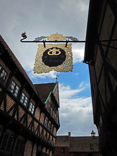 Old bakery sign and a half-timbered building at Den Gamle By, recreated villages set in different times, in Aarhus, Denmark