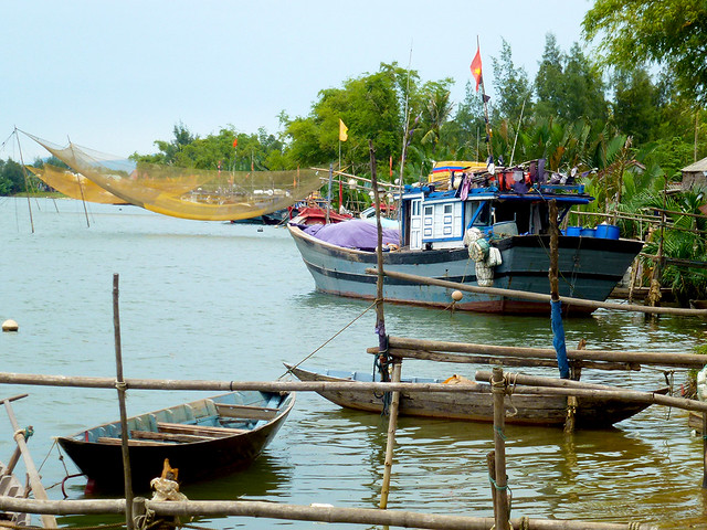 Present day Fishing boat moored on the Thu bon river upstream from Hoi An in South Central Vietnam