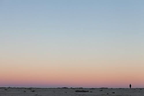 Fisherman and ocean sunset