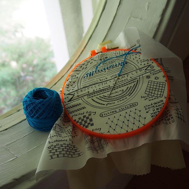 In progress, in the round window. I'm doing Rebecca Ringquist's class on Creativebug with one of her samplers and it's fun!