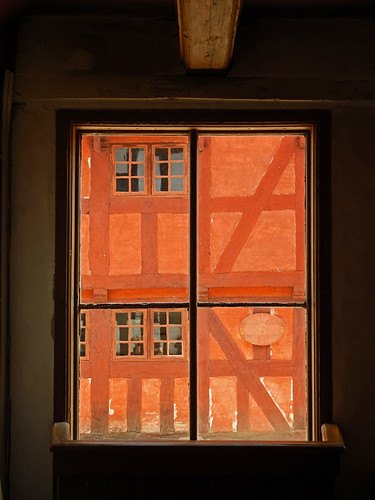A window on an old half-timbered building in Den Gamle By, recreated villages set in different times, in Aarhus, Denmark