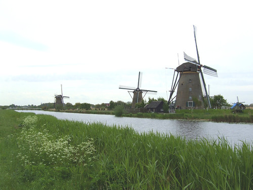 beautiful windmills next to a river