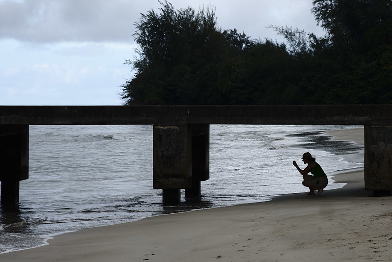 Photographer under Hanalei Pier