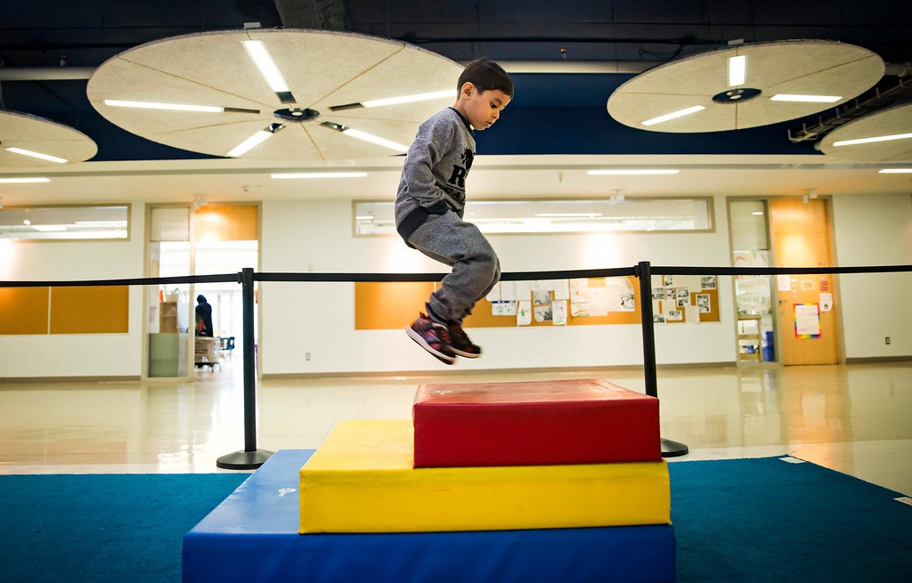 Jumping through a series of steps during gross motor class.CreditTara Walton for The New York Times
