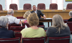 State Rep. Craig Fishbein talks with residents during a town hall meeting in Cheshire. The meeting, hosted by Rep. Fishbein and State Sen. Suzio, was attended by about 20 people who discussed various topics,including the state budget deficit.