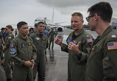 CLARK AIR BASE, Philippines (July 11, 2018) Rear Adm. Joey Tynch, Commander, Task Force 73, interacts with U.S. Navy sailors from Patrol Squadron Four (VP-4) and Philippine Navy sailors participating in a tour of a P-8 Poseidon maritime surveillance aircraft as a part of Maritime Training Activity (MTA) Sama Sama 2018. The week-long engagement focuses on the full spectrum of naval capabilities and is designed to strengthen the close partnership between both navies while cooperatively ensuring maritime security, stability and prosperity. (U.S. Navy photo by Mass Communication Specialist 2nd Class Joshua Fulton/Released)