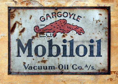Mobiloil sign in a garage in Den Gamle By, a recreated old village in Aarhus, Denmark