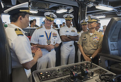 SAN FERNANDO CITY, Philippines (July 9, 2018) Captain Erwin Lao (left), commanding officer of USNS Millinocket (T-EPF 3), explains the Millinocket's bridge capabilities to Rear Adm. Joey Tynch, Commander, Task Force 73 (center-left), Capt. Lex Walker, Commodore, Destroyer Squadron 7 (center), Philippine Lt. Gen. Emmanuel Salamat, Commander, Northern Luzon Command (right), during a ship tour as a part of Maritime Training Activity (MTA) Sama Sama 2018. The week-long engagement focuses on the full spectrum of naval capabilities and is designed to strengthen the close partnership between both navies while cooperatively ensuring maritime security, stability and prosperity. (U.S. Navy photo by Mass Communication Specialist 2nd Class Joshua Fulton/Released)