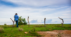 Man leaning on a fence in rural Kenya
