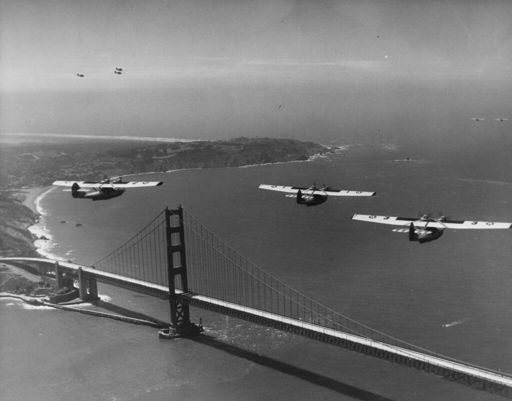 Consolidated PBY-1 Catalina patrol bombers. Fly in formation over the southern end of the Golden Gate Bridge, San Francisco, California, in May 1937. These PBY's are from VP-9.