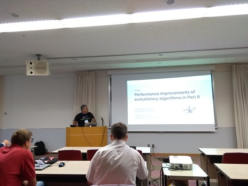 Mario presenting the paper on Perl 6 evolutionary algorithms