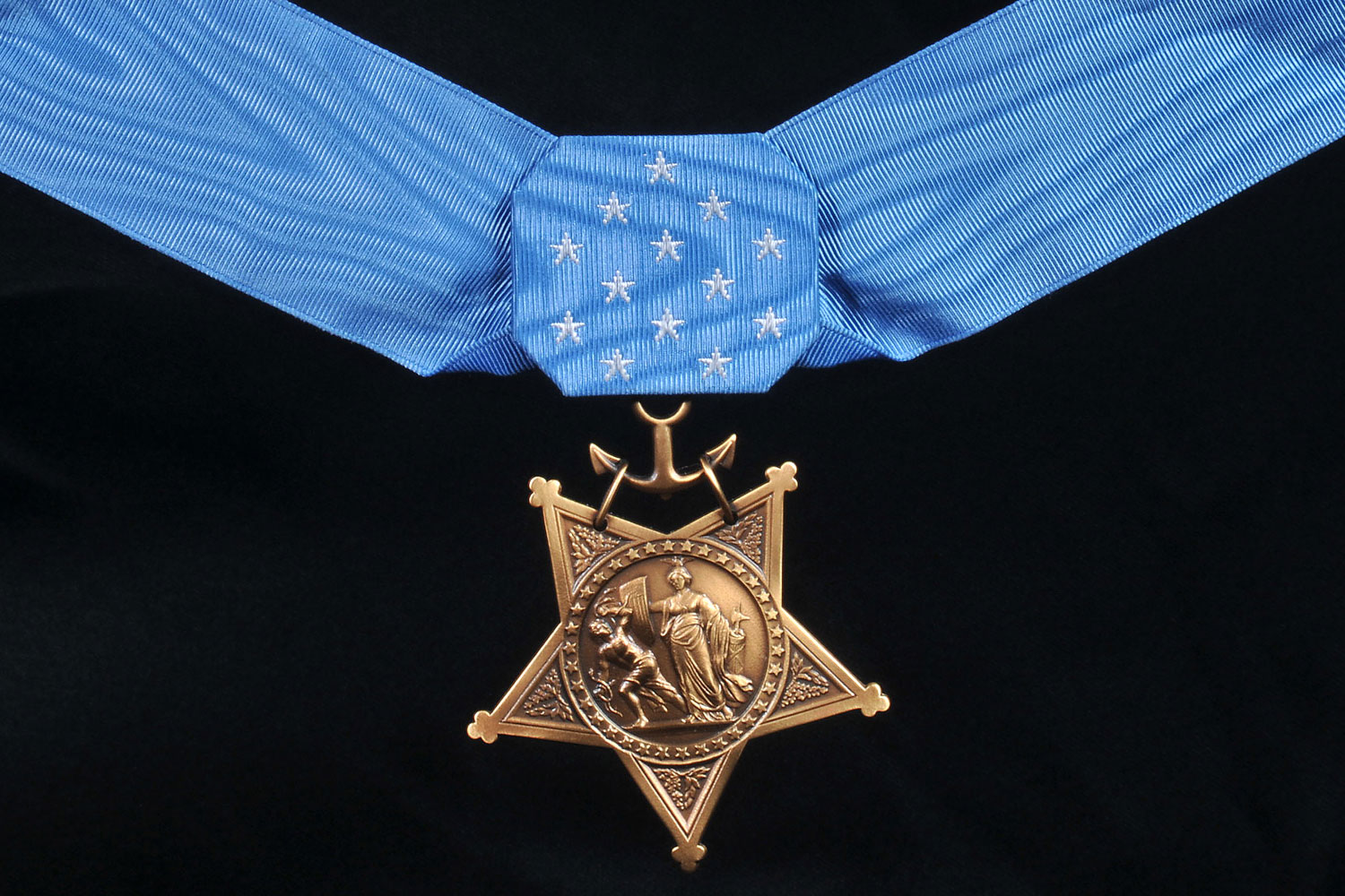 The Navy Medal of Honor — the first to be commissioned — depicts the Roman goddess of war, Minerva, as a symbol of the United States. She is battling Discord, represented by a person grasping snakes. Minerva is holding a bundle of rods known as a fasces to symbolize authority and strength through unity. In her other hand is the shield from the U.S. coat of arms. This medal also is given to members of the Marines and Coast Guard.