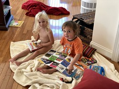 The twins thumb through their books after arriving home from the lake house