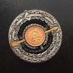 Roman Butin coin trap carving