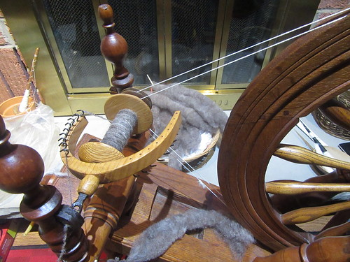 Spinning handcarded rolags by irieknit on Antique Canadian saxony flax wheel