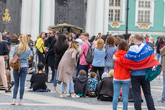Numerous tourists in front of the Hermitage Museum in Saint Petersburg