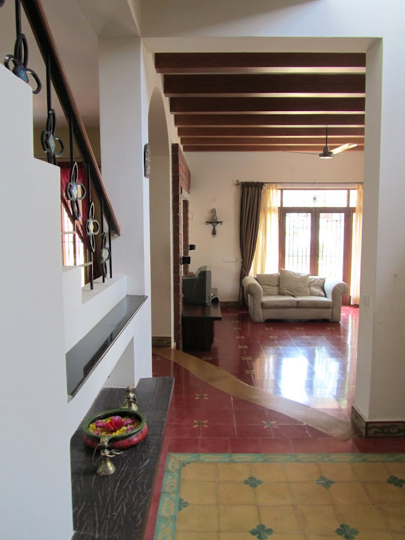 Interior design: A traditional South Indian home with athangudi floor tiles and wooden rafters.