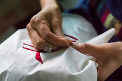 Woman sewing by hand - detail