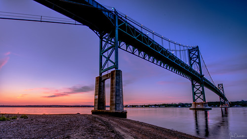 mounthopebridge narragansettbay rhodeisland newport aquidneck bridge structure archtecture suspensionbridge water reflection sky sunrise sunset beach morning evening twilight