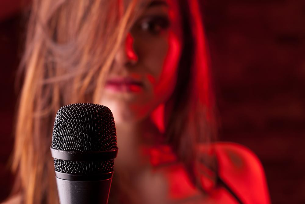 frightened singer in front of a microphone