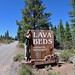 David sleeping by the side of Lava Beds sign by daveynin