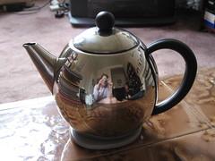wheel(0.0), tea(0.0), drink(0.0), iron(0.0), art(1.0), tableware(1.0), kettle(1.0), teapot(1.0),