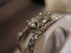 hand(0.0), wedding ring(0.0), jewellery(1.0), diamond(1.0), close-up(1.0),