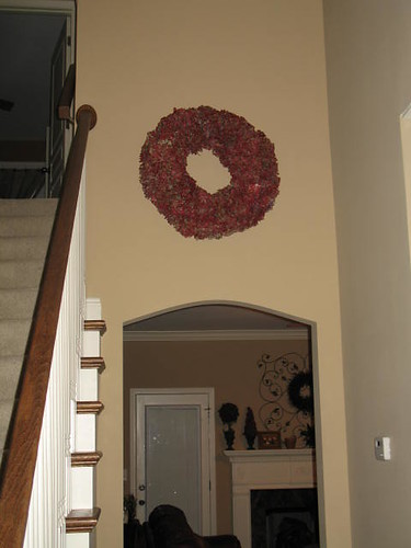 red hydrangea wreath on staircase