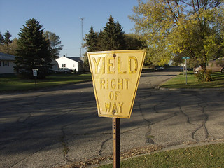 Old keystone-shaped yellow yield sign, Petersburg, North Dakota