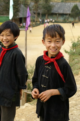 Hmong boy with dark clothes it Ban Pho Village