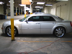 automobile(1.0), automotive exterior(1.0), wheel(1.0), vehicle(1.0), performance car(1.0), rim(1.0), chrysler 300(1.0), bumper(1.0), sedan(1.0), land vehicle(1.0), luxury vehicle(1.0),